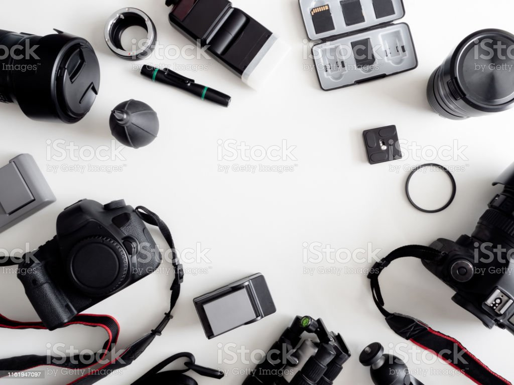 top view of work space photographer with digital camera, flash,...