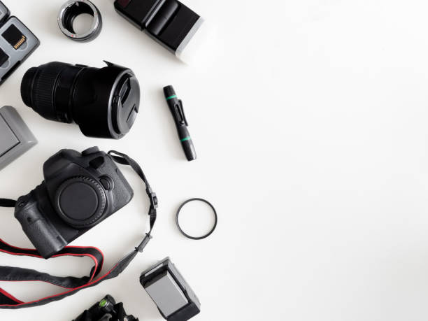 top view of work space photographer with digital camera, flash, cleaning kit, memory card, tripod and camera accessory on white table background top view of work space photographer with digital camera, flash, cleaning kit, memory card, tripod and camera accessory on white table background camera photographic equipment stock pictures, royalty-free photos & images