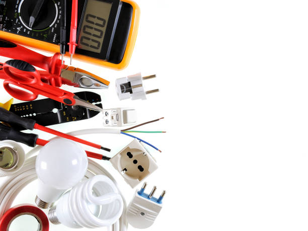 Top view of working tools and components of the electrical system on white background. stock photo
