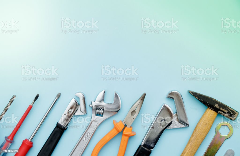 Top view of Working tools, wrench, socket wrench, hammer, screwdriver, plier, electric drill, water balance on flat lay background. Fathers day royalty-free stock photo