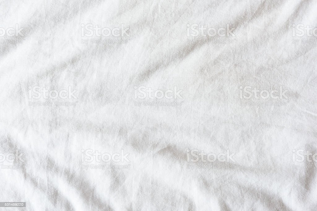 Top View Of Wrinkles On Untidy White Bed Sheet Stock Photo