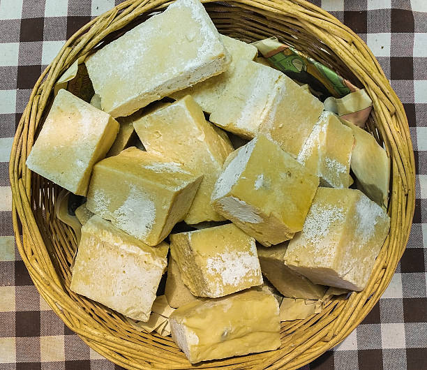 Top view of yellow organic handmade soaps in a basket stock photo