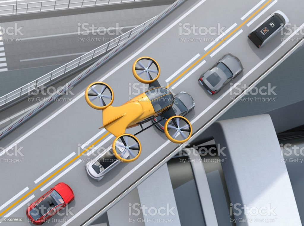 Top view of yellow passenger drone flying over cars in heavy traffic jam stock photo