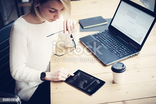 629421870 istock photo Top view of young beautiful woman working at the wooden 638549048