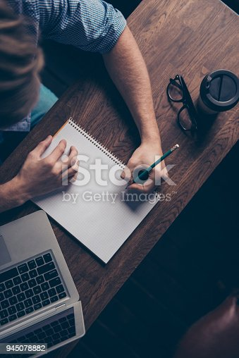 istock Top view of young man writing in his notebook 945078882