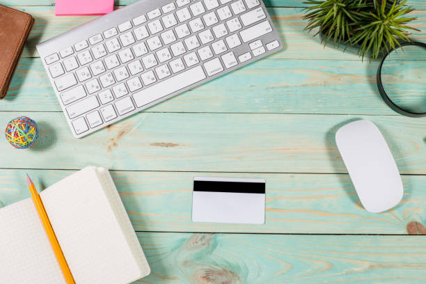 top view office table and blank credit card on wood background. - top view, wood table, empty imagens e fotografias de stock