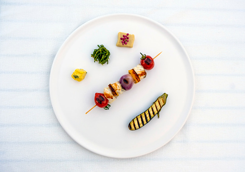 Food decoration concept: Fine dining plate in luxury restaurant. Perfectly served plate with vegetables. Fresh food background with large copy space.