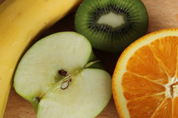 Top view on banana, apple, kiwi and orange stock photo