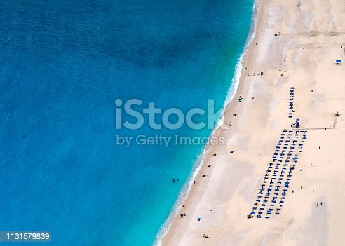 811600544 istock photo Top view on Beautiful Myrtos beach with turquoise water and boy on the island of Kefalonia in the Ionian Sea in Greece 1131579839