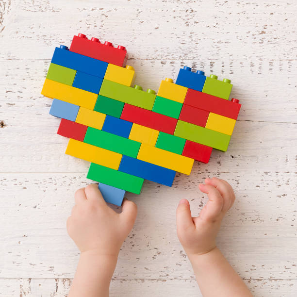 Top view on childs hands with heart made of colorful plastic bricks picture id1057491950?b=1&k=6&m=1057491950&s=612x612&w=0&h=pzb4vsdmmn72brnkwyhx y0cpbdlcmkihy1 0gtuiss=
