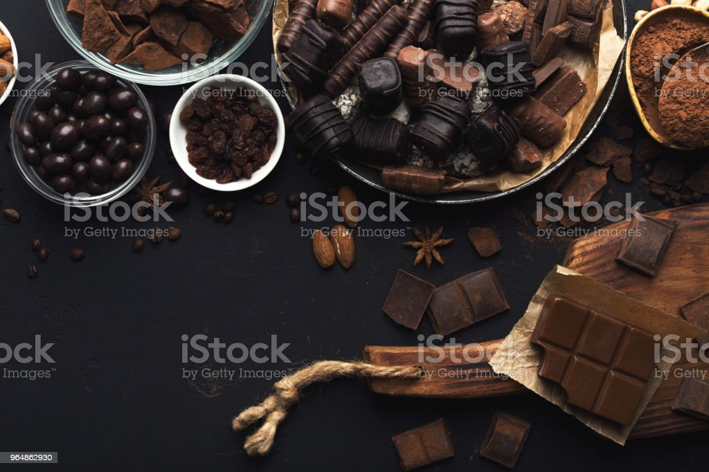 Top view on chocolate and nuts on black background royalty-free stock photo