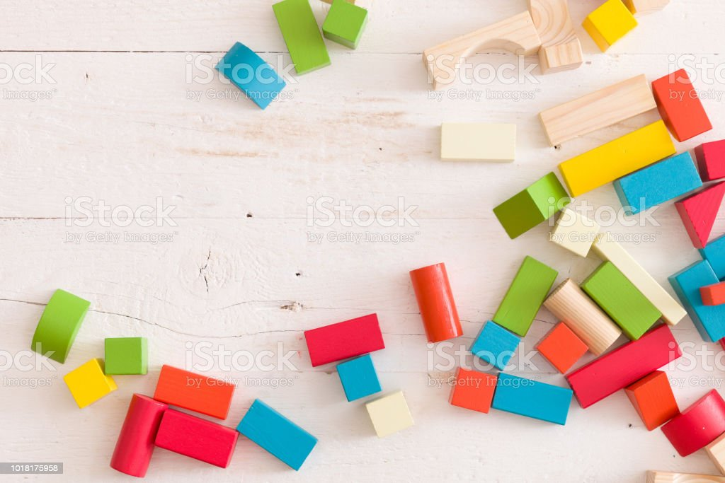 Top View On Colorful Wooden Bricks On The White Table Background