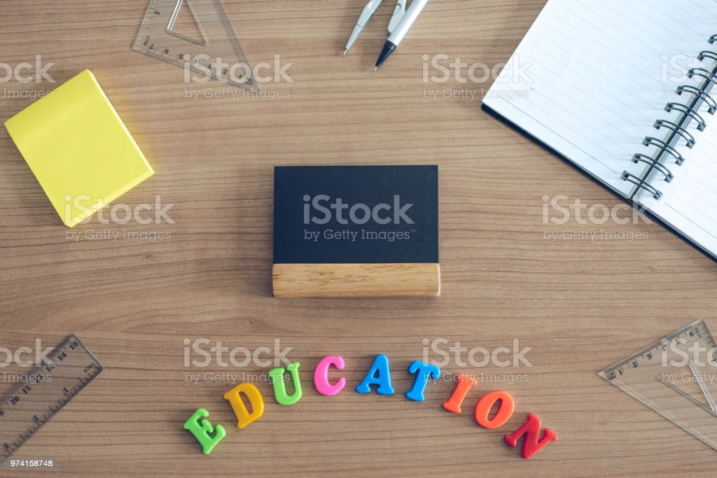 Top View On Education School Desk With Small Chalkboard And Post Note.