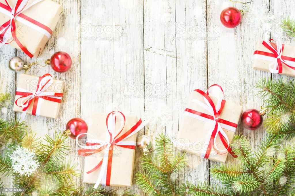 Top View On Frame From Christmas Decorations Gift Boxes Fir Branches On The Wooden Background Decorated With Snow Stock Photo Download Image Now Istock