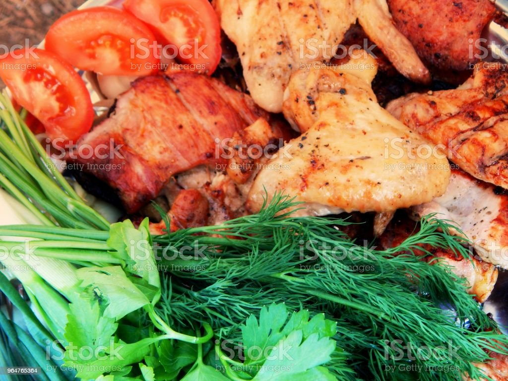 Top view on fried meat with green goods and vegetables detailed royalty-free stock photo