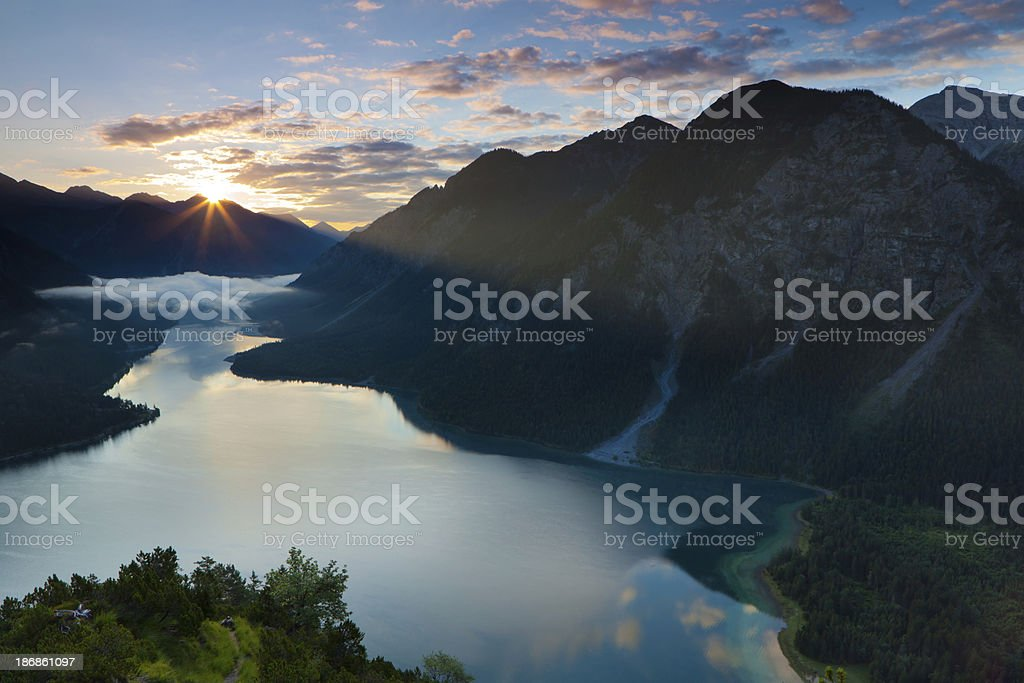 top view on lake plansee with sunrise, tirol, austria, alps stock photo
