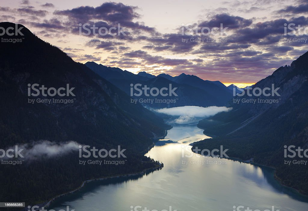 top view on lake plansee with sunrise, tirol, austria, alps royalty-free stock photo