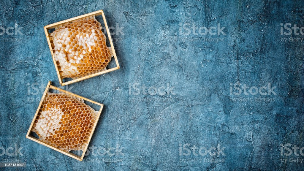 Top view on natural product honeycomb in wooden frames as organic...