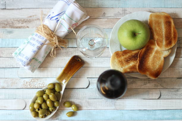 Top view on olives, wine, apple and toast stock photo