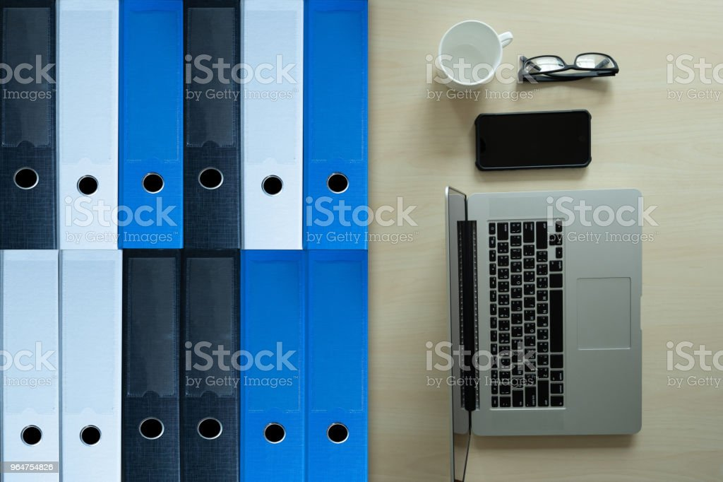 top view on phone business  archive files into a filing  data storage Meeting Design Ideas royalty-free stock photo