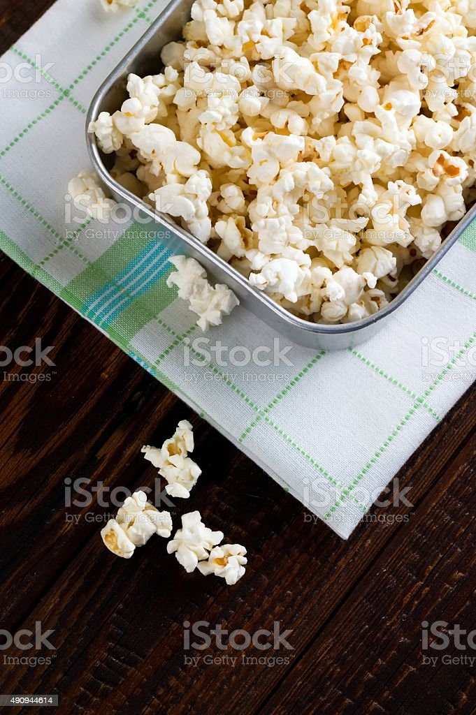 Top view on popcorn in old pan stock photo