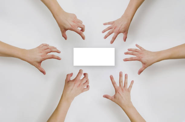 Top view on Pulling out hands for something. stock photo