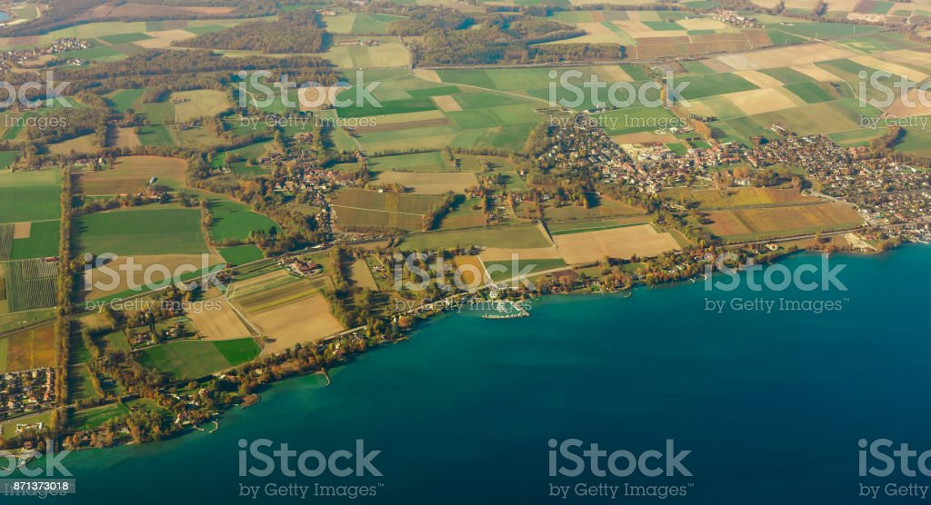 Top view on the city many small houses on the coast of the lake ohrid with docks and moored ships old city and waterfront in switzerland stock photo