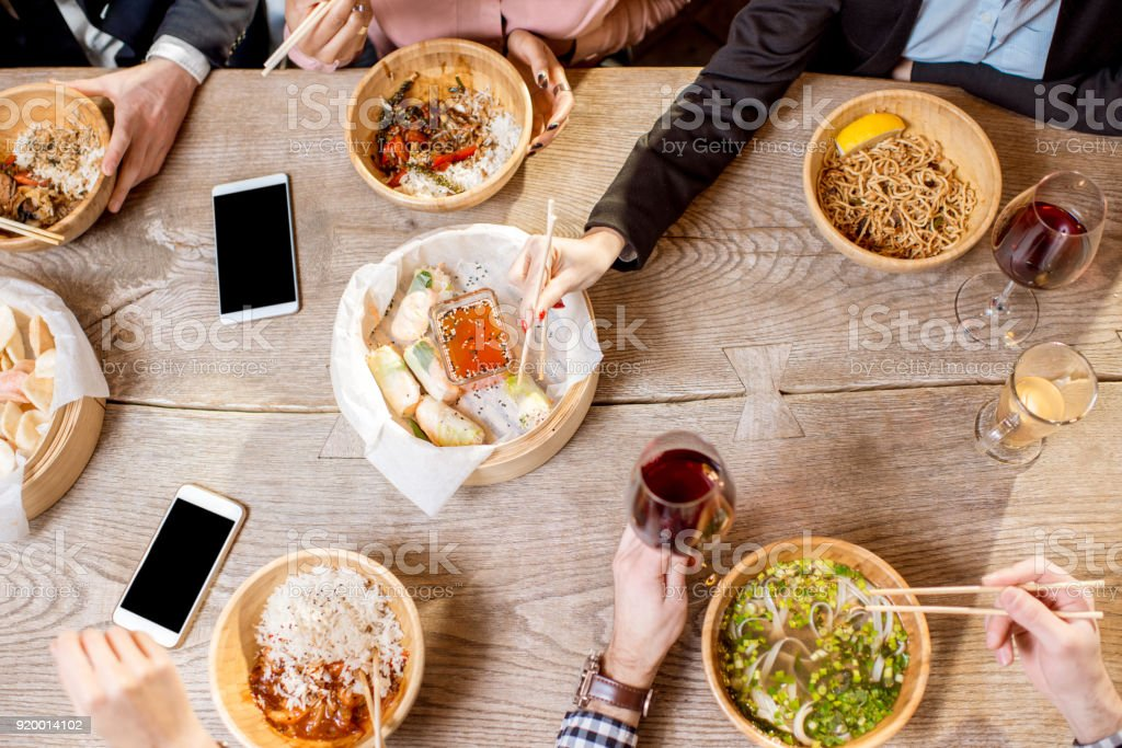 Top view on the table full of asian meals stock photo