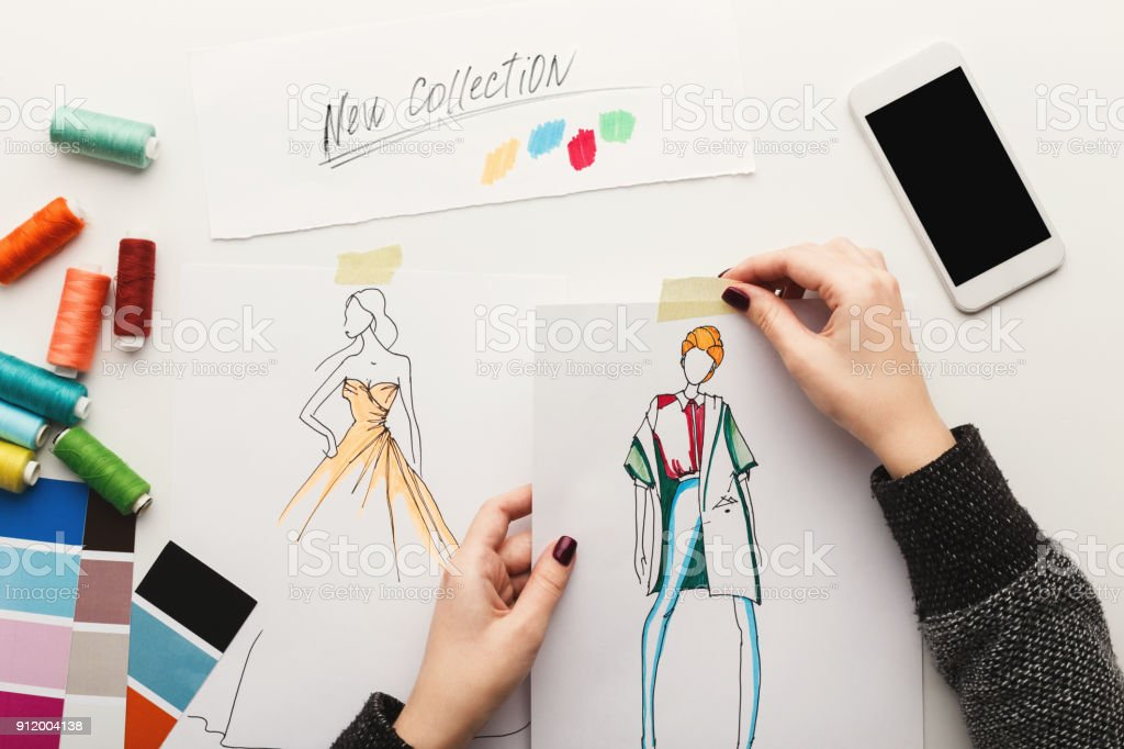 Designer Clothes Sketches | Top View On Woman Designer Drawing Clothes Sketches Stock Photo