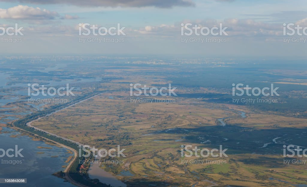 Top view or bird's-eye view of ground landscape with fertile soil and grass land in green and brown color. stock photo