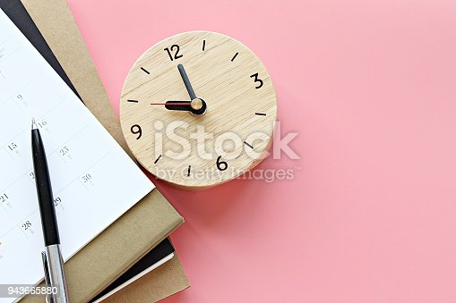 istock Top view or flat lay of notebooks, calendar, clock and pen on pink background 943665880