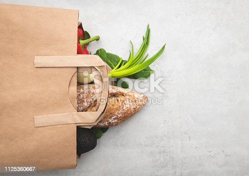 istock Top view paper bag of different fresh health food 1125360667