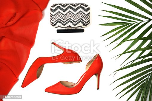 1078252326 istock photo Top view party outfit red coral shoes accessories clutch tropical leaves on white background, isolated. 1155254399