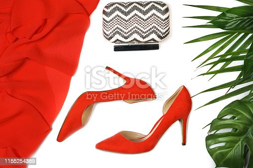 1078252566 istock photo Top view party outfit red coral shoes accessories jewelry clutch tropical leaves on white background, isolated. 1155254389