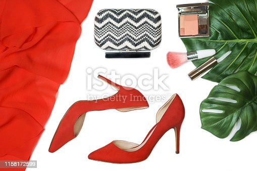 1078252326 istock photo Top view party outfit red shoes, accessories makeup cosmetics, clutch, tropical monstera leaves on white background isolated. 1158172599