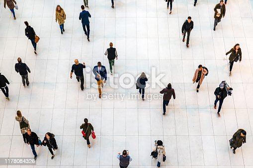 istock Top view people walking white floor or large crowd of anonymous people. 1178084326