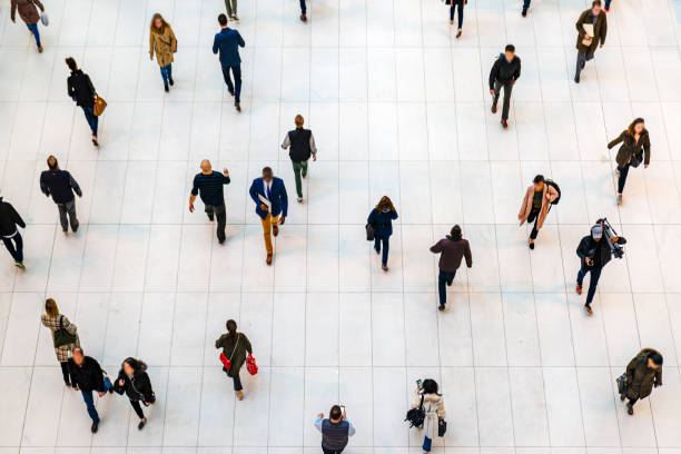 Top view people walking white floor or large crowd of anonymous people. stock photo