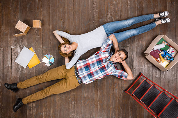 Top view photo of couple on wooden floor stock photo