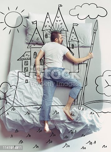istock Top view photo of young man sleeping in a big white bed and his dreams 1141914911