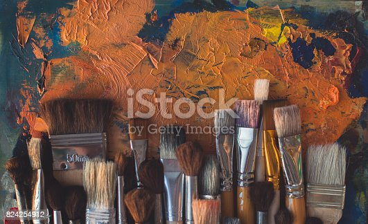 istock Top view picture of wooden paintbrush set different size with old palette on the background. 824254912
