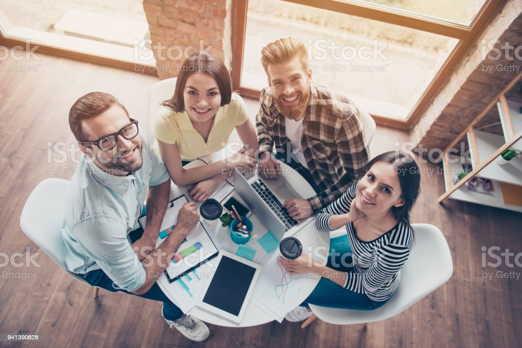 Top view picture of young happy smiling people speaking about the advantages of new business project stock photo
