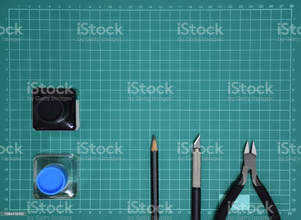 Top view Plastic model tool kit ink, art knife, cutting pliers on...