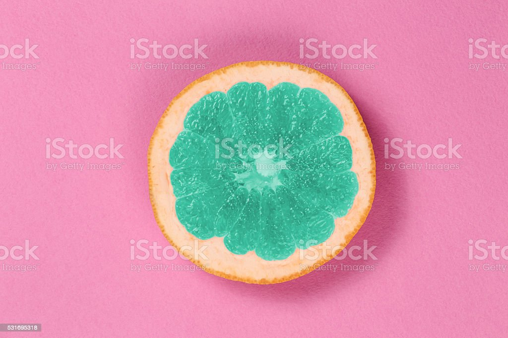 Top view popart grapefruit green color on a pink background stock photo