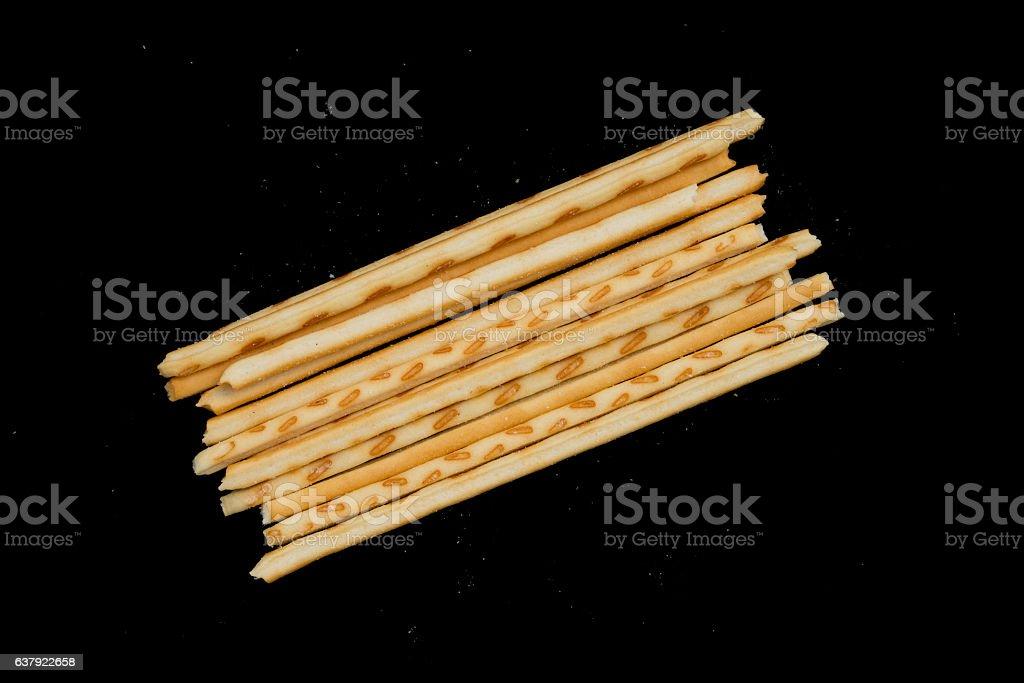 top view pretzel sticks on a black background stock photo