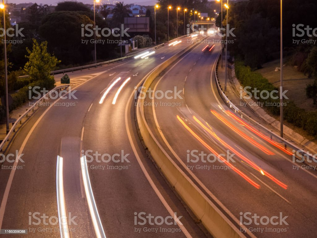 Top View Road in the evening with car lights and street lights