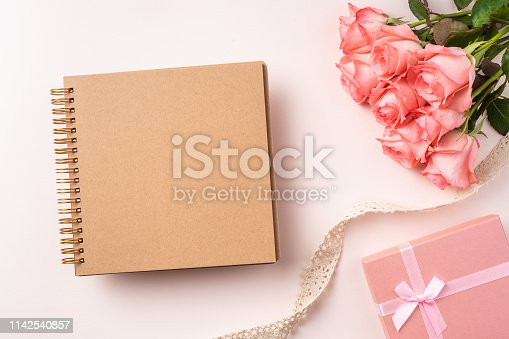 825251738istockphoto top view rose on pink for mothers , valentines day 1142540857