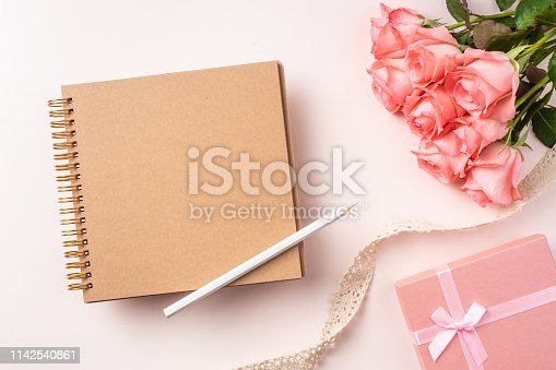 825251738istockphoto top view rose on pink for mothers , valentines day 1142540861
