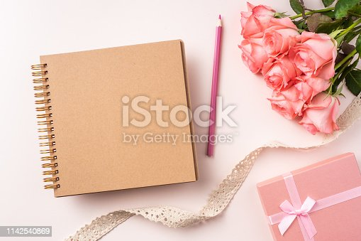 825251738istockphoto top view rose on pink for mothers , valentines day 1142540869
