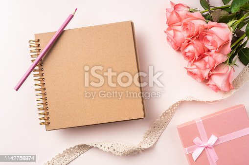 825251738istockphoto top view rose on pink for mothers , valentines day 1142756974