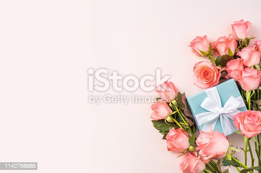 event design concept - top view of a bunch of pink rose and gift box on pink background for mothers day and valentines day, wedding event with copy space for mock up